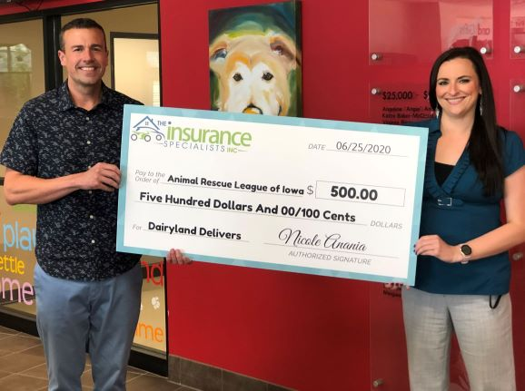 The Insurance Specialists Inc, Justin Oliver, giving check to Animal Rescue League